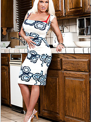 Radiant wife Ashlee Chambers posing in her kitchen and rubbing boobies