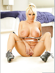 Erotic housewife Holly Halston playing with tits and fingering vagina