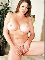 Arresting milf June Summers posing naked and playing with her tits