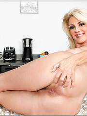 Pretty mom Penny Porsche stripping and fingering pussy like nobody else