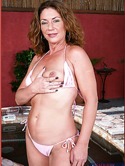 Alex Nevada is a naughty milf, who rubs her sexy pussy and enjoys