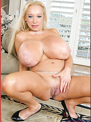 Horny blonde mature Echo Valley takes off her great bra and rubs huge tits