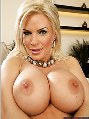 Passionate blonde milf Diamond Foxxx takes off her bra and shows sexy boobs