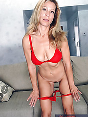 Pretty milf Kimmie Morr looks sexy in the alluring red lingerie