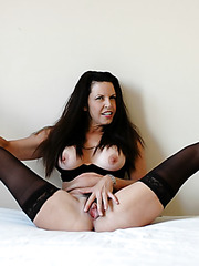 Dark haired milf Selena Steele shows her hairy pussy and enjoys