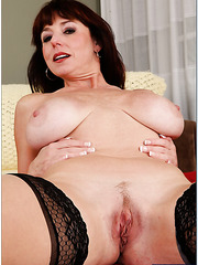Super busty mature lady Karen Kougar beckons young guy with her forms