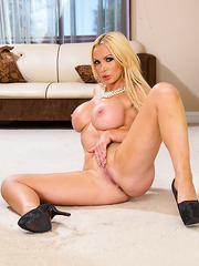Naughty blonde angel Nikki rubs her alluring pussy and shows it to you