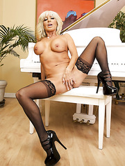 Naughty blonde mature Tara Holiday udresses her lingerie for a crazy scene