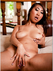 Elegant Asian lady Sharon Lee rubs her great body and delicious boobs