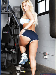 Appealing and arresting blonde with big boobs Shyla Stylez poses and fucks in the gym