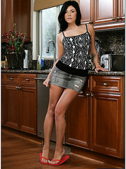 Astonishing brunette Andy San Dimas showing her tattoos and body in the kitchen