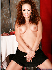 Lovely bitch Audrey Hollander with some curly hair showing her boobs