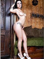 Noteworthy brunette Julia Bond is posing naked with her tattoos for camera