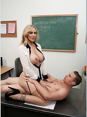 Naughty chick Julia Ann shows her big tits and rides a young cock