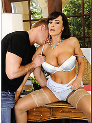 Sexy milf Lisa Ann spreads her legs for a hardcore and hot fuck