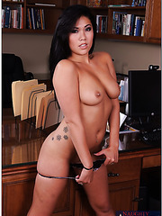 Busty brunette with Asian notes London Keyes poses and fucks right in the office