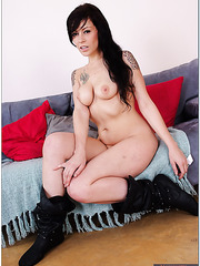 Vanessa Naughty as the name suggests is posing in a horny way undressed
