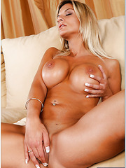 Staggering whore Klarisa Leone being naked and posing in her red high-heels