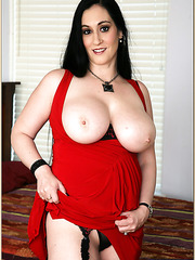 Stunning Raven taking off her red dress and revealing her huge breasts