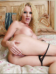 Horny milf Dani Sexton posing in jeans and doing a striptease before sex