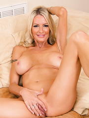 Wild blonde milf Emma Starr likes to show off and masturbate her wet pussy