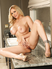 Gorgeous housewife Julia Ann showing her busty and delicious body and tits