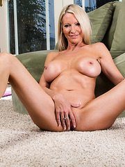 Delightful milf Emma Starr is revealing her huge boobs and her fine ass