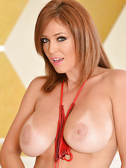 Sweet cougar babe Charlee Chase wearing a red bikini and showing her melons