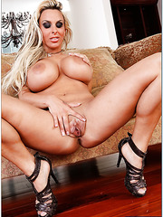 Mesmerizing whore Holly Halston teasing big tits in an awesome solo action