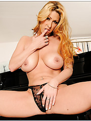 Dazzling hooker Tiffany Mynx stripping on camera and playing with pussy