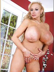 Chubby whore Echo Valley posing in high heels and licking boobies