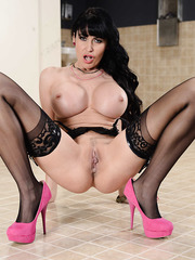 Amazingly hot and buxom milf Eva Karera shows off her treasures in the toilet