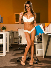 Big titted fascinating babe in sexy glasses Madison Ivy presents awesome striptease