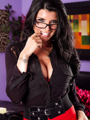 Brunette boss lady Romi Rain becomes a horny whore right in the office