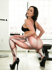 Amazing milf with hot ass and big tits Kendra Lust poses in the gym