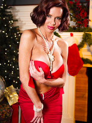 Classy milf Veronica Avluv taking off red dress and enjoying a yummy rod