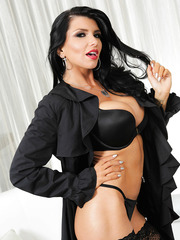 Happy brunette Romi Rain loves posing in lingerie and jilling wet sissy