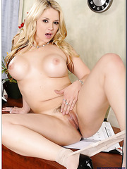 Pretty milf Sarah Vandella posing in stockings and showing her awesome tits
