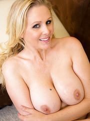 Bewitching milf Julia Ann having fun in her office with a handsome stranger