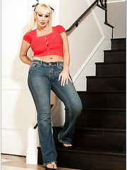 Glamorous milf Brittany O'Neil stripping on stairs and getting satisfied