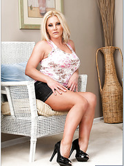 Superior milf Charity McLain posing on the floor and waiting for a big rod