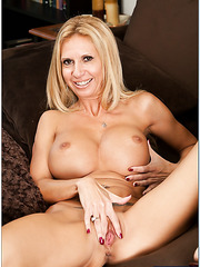 Crazy milf Brooke Tyler fingering on the sofa and getting a delicious wiener