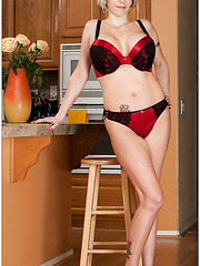 Elegant milf Kasey Grant stripping in kitchen and pleasing her husband