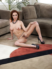 Giggly wife Ashlee Graham posing on sofa and tasting a marvelous wiener