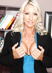 Glamorous milf secretary Emma Starr poses naked on the leather chair