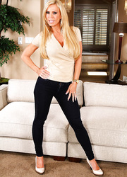 Raunchy hooker Amber Lynn taking off jeans and posing on the sofa
