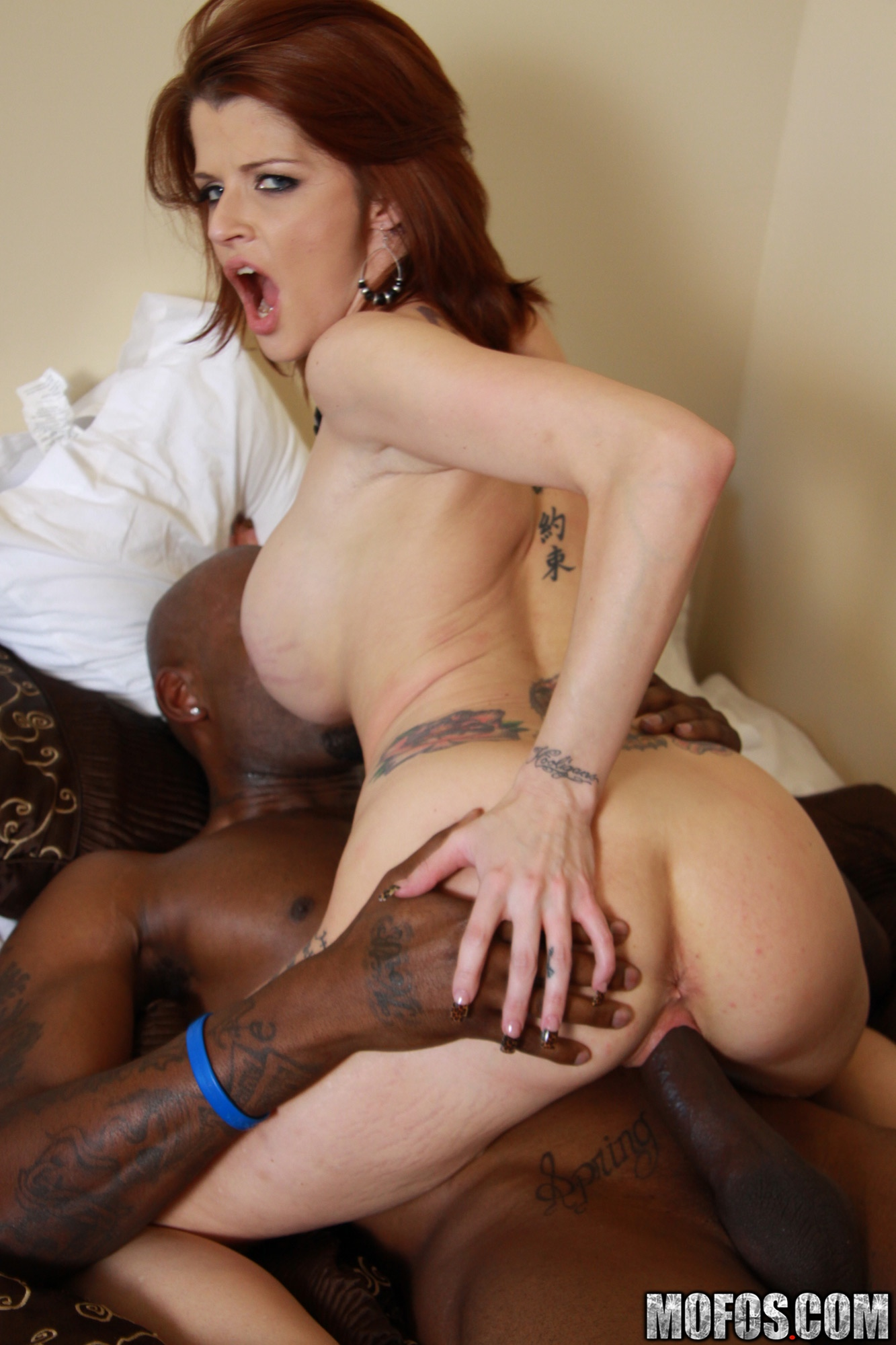 image Redhead milf blacked in her mouth and ass