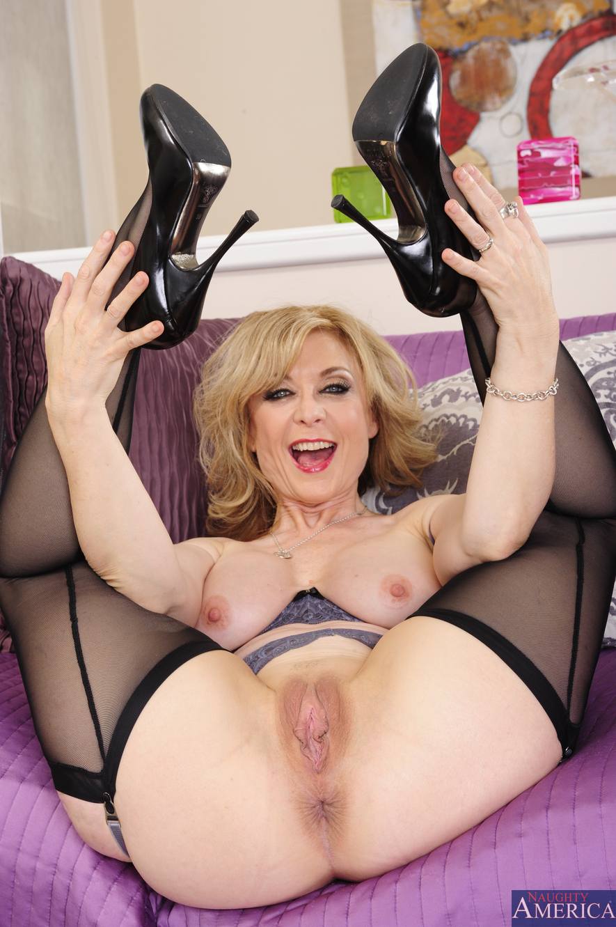 Granny in stockings likes a glass of wine with her cock 9